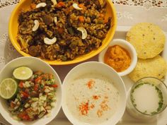 A meal spread from Anuradha Sawhney's vegan wellness center in Pune, 'Back to the Basics': Brown rice biryani with cucumber raita. Corn idlis with carrot chutney. Kachumber salad. Pumpkin amla health drink.