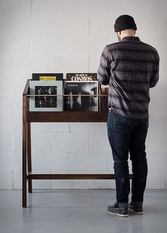 Record Display I is a beautifully handmade vinyl record display built with solid walnut, and with brass details, by Japanese furniture maker Kai Takeshima in Montreal, Canada. Finished with oil for a sleek look, the elegant display features six diffe