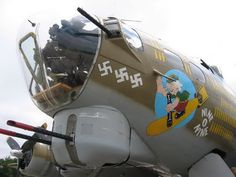 Google Image Result for http://www.aircraftnoseart.net/B-17_Nine_o_Nine_Aircraft_WWII_Nose_art.jpg