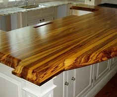 "2 1/4"" thick zebrawood premium wide plank countertop. Natural color with Marine Oil Finish and a Built Up ogee-J Edge"