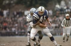 All-pro Mel Renfro (20) brings down Baltimore Colts running back Tom Matte (41) in this 1967 game at Baltimore's old Memorial Stadium.