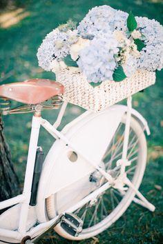 Flower filled bike | Anastasiya Belik Photography | http://burnettsboards.com/2013/12/powder-blue-white-wedding/