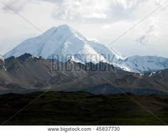 This snow-capped mountain provides a beautiful backdrop to tundra in Alaska's Denali National Park. ©Photo copyright by Marty Nelson. Photographer website: http://www.bigstockphoto.com/search/?start=450&contributor=Marty+Nelson+Photo+Art