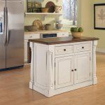 Home Styles Monarch Kitchen Island - The stylish antique design of the Home Styles Monarch Kitchen Island is both warm and welcoming and the level of convenience it provides isn't too bad...