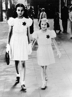 Belgium • Two girls in white with dark Jewish Stars Keizerlei Antwerpen 1942