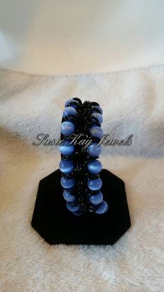 Check out this item in my Etsy shop https://www.etsy.com/listing/233646113/blue-cats-eye-bracelet