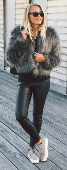Fur coats are a must have this fall. Wear yours with black jeans or leggings like Janni Deler to keep all attention on your statement fur piece. Via Just The Design. Fur: DryLake, Top: Bershka, Leggings: From Spain, Shoes: Jennie-Ellen.