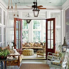 Floor-to-ceiling windows, bright fabrics and a hanging porch swing create an outdoor feel for this enclosed porch. ● Tour the Daufuskie Island House < Porch and Patio Design Inspiration - Southern Living Mobile