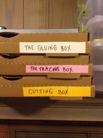 Making busy boxes out of repurposed pizza boxes.