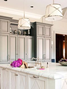 This kitchen is elegant and classy! The pendants are to die for, and the I love the contrasting paint colors for the cabinets.  The mercury glass accents are gorgeous and the nickel fixtures are just my style.  I would love to bake on that amazing island!