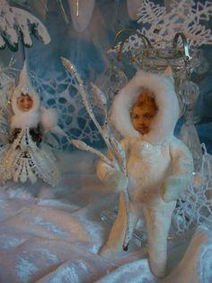 little snowchild with winter-branchlet kleines Schneekind hält einen Winterzweig