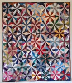 Endless Chain quilt by Glenna Hailey at Hollyhock Quilts.  Made from a combination of new and antique fabrics, mostly plaids. This quilt was paper pieced and finished with vintage buttons instead of quilting.