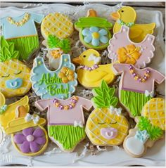 """The Sugar Jar on Instagram: """"Luau baby shower cookies for a baby boy and girl! Such a fun theme! 🍍👶🏼 #decoratedsugarcookies #decoratedcookies #babyshowercookies #babycookies #luaubabyshowercookies #luaubabyshower #hawaiianbabycookies #thesugarjar #sugarcookies"""""""