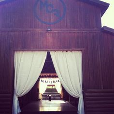 The barn at Moose Creek Ranch in Victor, Idaho with drapes !!! a venue in the Tetons - near Jackson Hole Wyoming that is hard to beat.