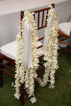 Decorate chairs with garlands of orchids | Brides.com