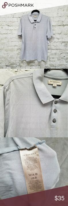 🎉Host Pick 3/28🎉 Mens Burberry London Polo AS IS New With Tags  Blue/Gray lightweight polo with textured check throughout. Item has never been worn, purchased from Nordstrom rack for my husband and didn't notice defects until later.    ***Please note the following defects*** Right Shoulder has a tiny hole going through the front and back from a security tag. (Photos 4 & 5) The collar is slightly dirty on the fold going around the neck- may come out with a wash. (Photos 6& 7)  Price…