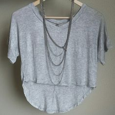 Heather gray high low cropped tee Super soft rayon / spandex.  Brand new without tags.   1 small available  2 medium available  2 large available   If you are interested in this item, I will create a custom listing for you :) Please do not purchase this listing. heart and hips Tops