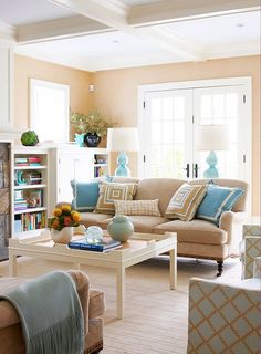 Love the soft color palette used of light camels, light blues and whites used throughout the house