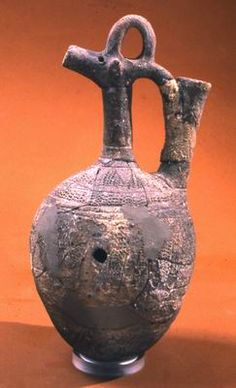 Juglet in the shape of a horned animal Tur'an Middle Canaanite period, first half of the 2nd millennium BCE Pottery H: 20; W: 9 cm Israel Antiquities Authority