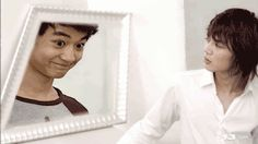 He has finally achieved his ultimate life goal.  At last, his reflection is showing who he is inside.