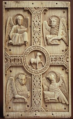 """Plaque with Agnus Dei on a Cross between Emblems of the Four Evangelists. Animals continued to play an important part in lore by inspiring and guiding the human characters or audience. """"Animals als served as vehicles for religious allegory and moral instruction."""""""