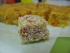Apricot Delight - makes 36  250g dried apricots, chopped  3/4 cup boiling water  2 tbsp honey  1 1/2 cups dessicated coconut  extra coconut, for coating