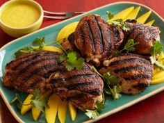 Jerk Rubbed Chicken Thighs with Home-Made Mango-Habanero Hot Sauce by Bobby Flay.