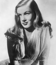 In a time when most movie starlets were sporting perfectly coiffed or pin-curled hairdos, Veronica Lake set the standard for Hollywood glamour with her long, flowing hair. This style works best for thick, wavy hair, but it works on all face shapes. The style is usually parted on the side and can be worn falling seductively over one eye, à la Veronica, for extra drama.