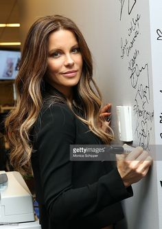Actress Kate Beckinsale signs the wall at AOL Studios when she visits for AOL…