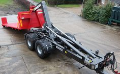 The HookLoada trailer can be used to handle a wide range of hook lift modules - shown here loading a Stronga flatbed