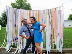 DIY Fabric/crepe paper/ ribbon photobooth back drop. Use diff colors.