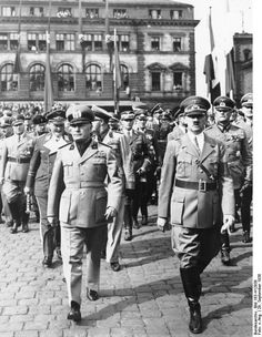 Benito Mussolini arriving in Munich, Germany for the Munich Conference, 29 Sep 1938; Adolf Hitler, Hermann Göring, Galeazzo Ciano, and Wilhelm Keitel also present