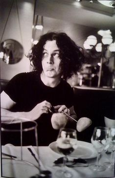 Jack White: Curiosity and creativity unbounded.  Not only is he cute as a button in this pic, but he's imitating Charlie Chaplin with the bread.  ...as a button!!