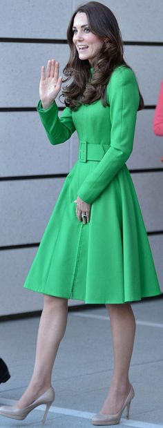 Kate Middleton wore a bespoke Catherine Walker coat dress.  http://www.dailymail.co.uk/news/article-2611805/Kate-William-arrive-Canberra.html  http://whatkatewore.com/2014/04/24/kate-goes-green-for-arboretum-parliament-portrait-gallery/
