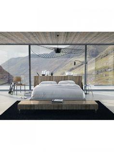 Slaapkamer met uitzicht op de bergen | ELLE