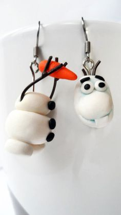 Kind Olaf the snowman earrings! Very cute and funny! :)) Would make a great gift for Frozen fans or treat yourself! Handmade pair of the Frozen movie