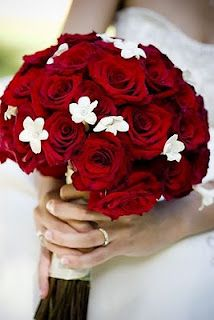 favorite red bouquet - use silver tulle and lots of black ribbon, also spray roses with a black sparkle glitter spray. - brides bouquet