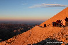 Be sure to wear warm clothes when you hike to the top of Mount Nemrut in Turkey to watch the sunrise. Magical!