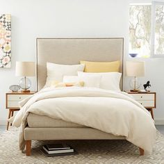 The complete package. In natural linen weave, the Nailhead Tapered Leg Bed features a lofty headboard and upholstered bed frame. Paired with the subtle curve of its saber legs, it's a sophisticated look for your bedroom.