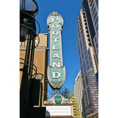 Low angle view of Portland landmark sign and modern skyscrapers Portland Oregon USA Canvas Art - Panoramic Images (27 x 9)