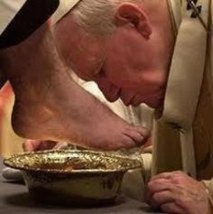 Humility. Pope John Paul II kissing feet during holy week.
