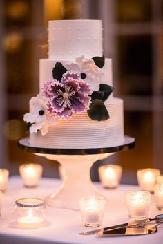 Beautiful wedding cake with purple gumpaste Sugarflower peony