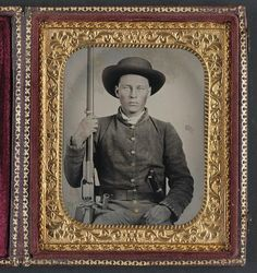 Soldier in Confederate uniform with Colt Revolving rifle and D-Guard Bowie knife