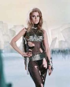 Jane Fonda US actress in costume with spots of blood on her arms torso and leg in a publicity portrait issued for the film 'Barbarella' 1968 The. Barbarella Movie, Jane Fonda Barbarella, Blake Edwards, Chris Tucker, Tippi Hedren, Tilda Swinton, Scene Photo, Movie Photo, Catherine Deneuve