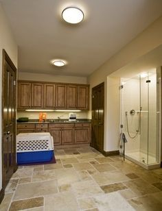 This bright laundry room combines practicality and good looks best exemplified…