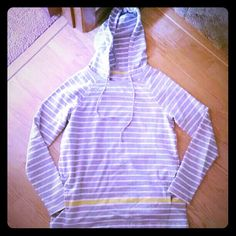 Talbots Hooded Sweatshirt This is a grey and white striped hooded sweatshirt. It has draw strings at the hood, two separate pockets on each side (they do not connect hands in the middle), and an accent yellow stripe near the bottom. It fits true to size, but is loose fitting so it could also fit a size medium. Super soft and comfy, great for lounging. This has never been worn. New without tags. Talbots Tops Sweatshirts & Hoodies