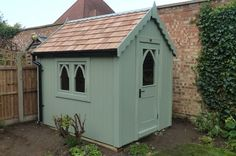 Gothic shed finished with sadolin superdec in jungle green. www.theposhshedcompany.co.uk