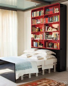 'A SINGLE MAN': Some Masculine Bedrooms for The Fellas (an outtake)...  A remote control operated bed in a Park avenue library/guest room designed by Bunny Williams. Photo by Roger Davies for Elle Decor.