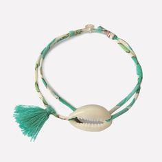 Bracelet cauri, pompon et Liberty cousu fin. / Liberty bracelet with cowrie / Handmade in France by ticha . www.ticha.bigcartel.com
