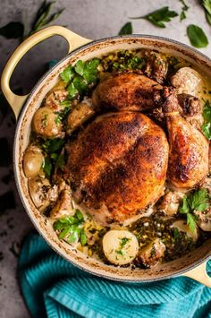 Creamy Lemon and Herb Pot Roasted Chicken This creamy lemon and herb pot roasted whole chicken is simple to make, decadent, and bursting with fresh flavors. The addition of little potatoes makes it a fantastic one pot meal that makes great leftovers! Dutch Oven Whole Chicken, Whole Roasted Chicken, Easy Dutch Oven Recipes, Dutch Oven Cooking, Ditch Oven Recipes, Easy Recipes, Dutch Oven Pot Roast, Dinner Recipes, Italian Cooking